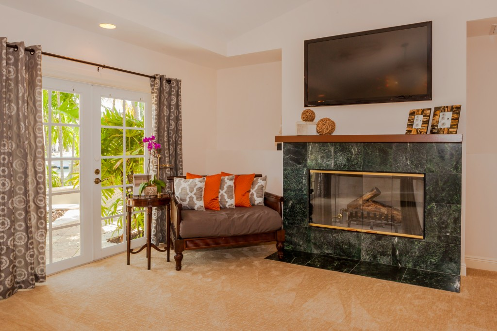 ADJUSTED 2449_del_lago_drive_MLS_HID1055692_ROOMmasterbedroomfireplace